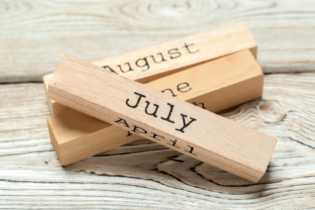top view of parts of wooden calendar on dark wooden tabletop